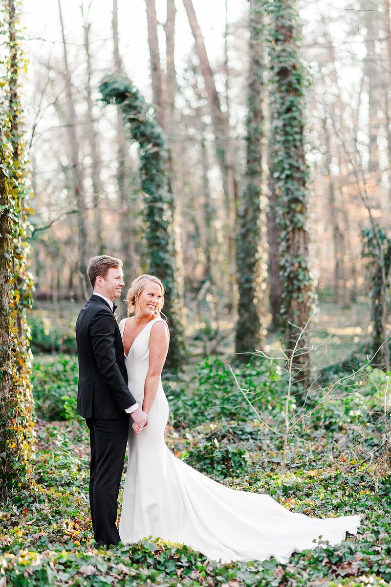 bride and groom standing in ivy by Knoxville Wedding Photographer, Amanda May Photos