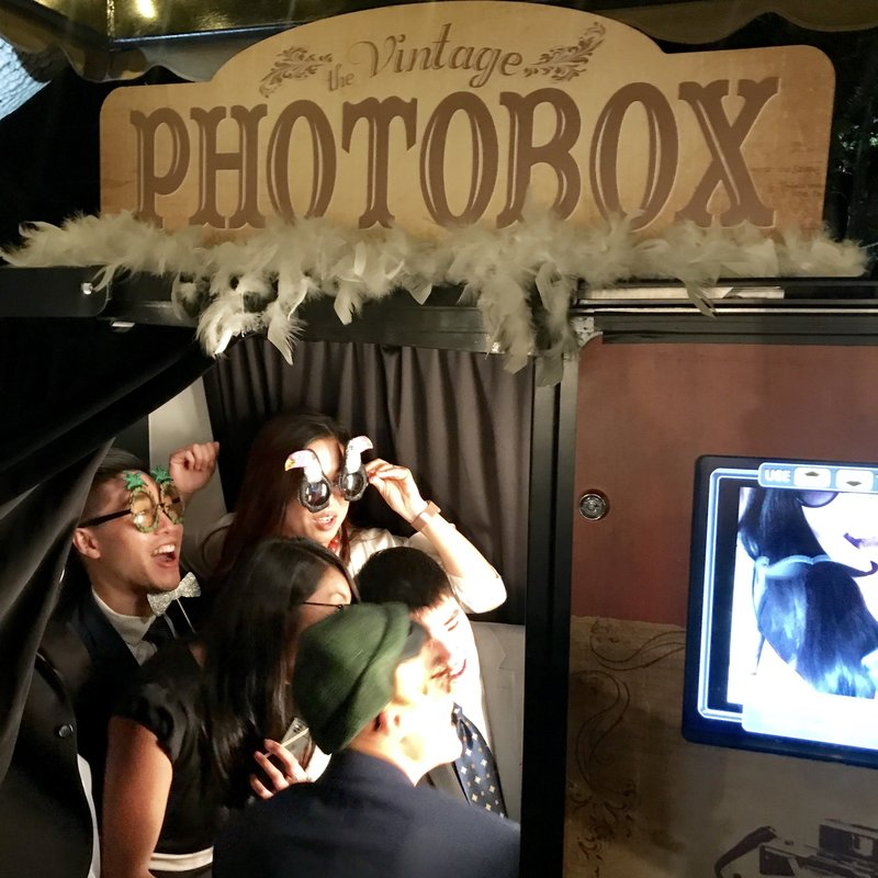 young adults having fun in classic photo booth
