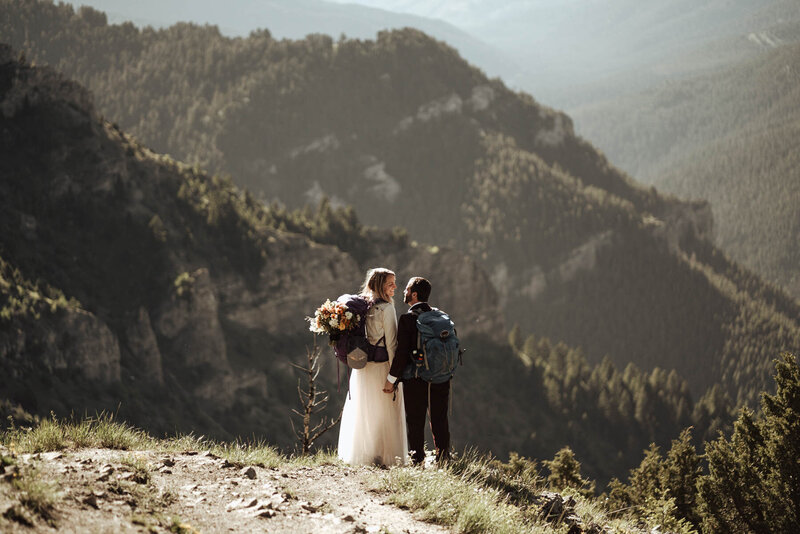 Backpacking bride and groom on top of a mountain in the Montana back country.