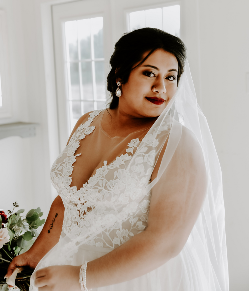 Woman in wedding dress facing right
