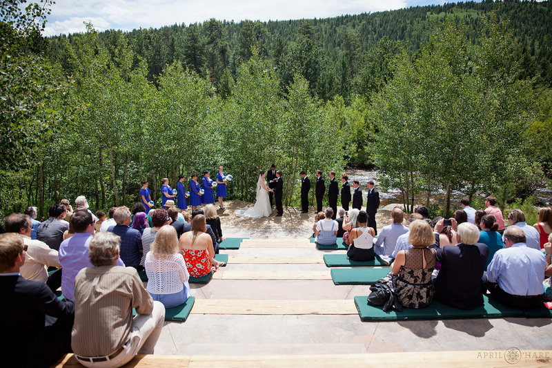 Wild-Basin-Lodge-Outdoor-Sunny-Wedding-Ceremony-next-to-River-in-Colorado