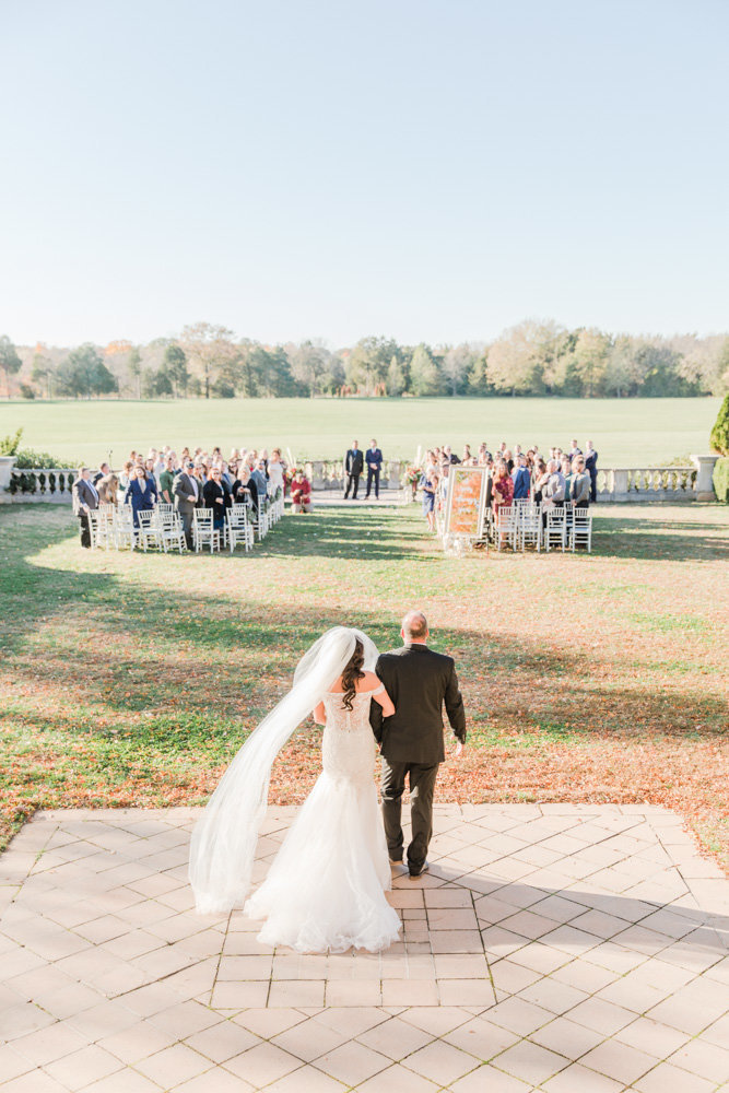 bride walking down the aisle with father at great marsh estate wedding in northern virginia by costola photography