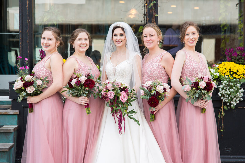bridesmaids in pink dresses outside of cityflats ballroom port huron