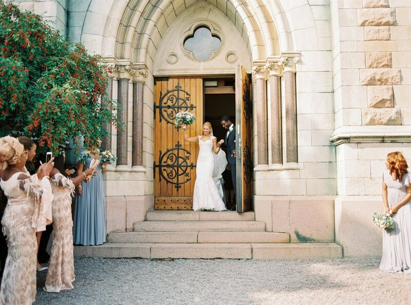 0015_Bride-and-groom-exiting-Oscars-kyrkan-after-the-wedding-ceremony