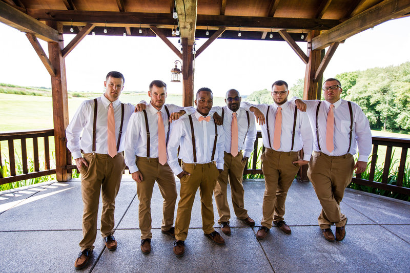 Groom poses with groomsmen at Betsy's Barn wedding