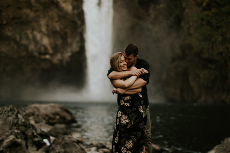 Snoqualmie Falls WA Engagement Couple Embracing
