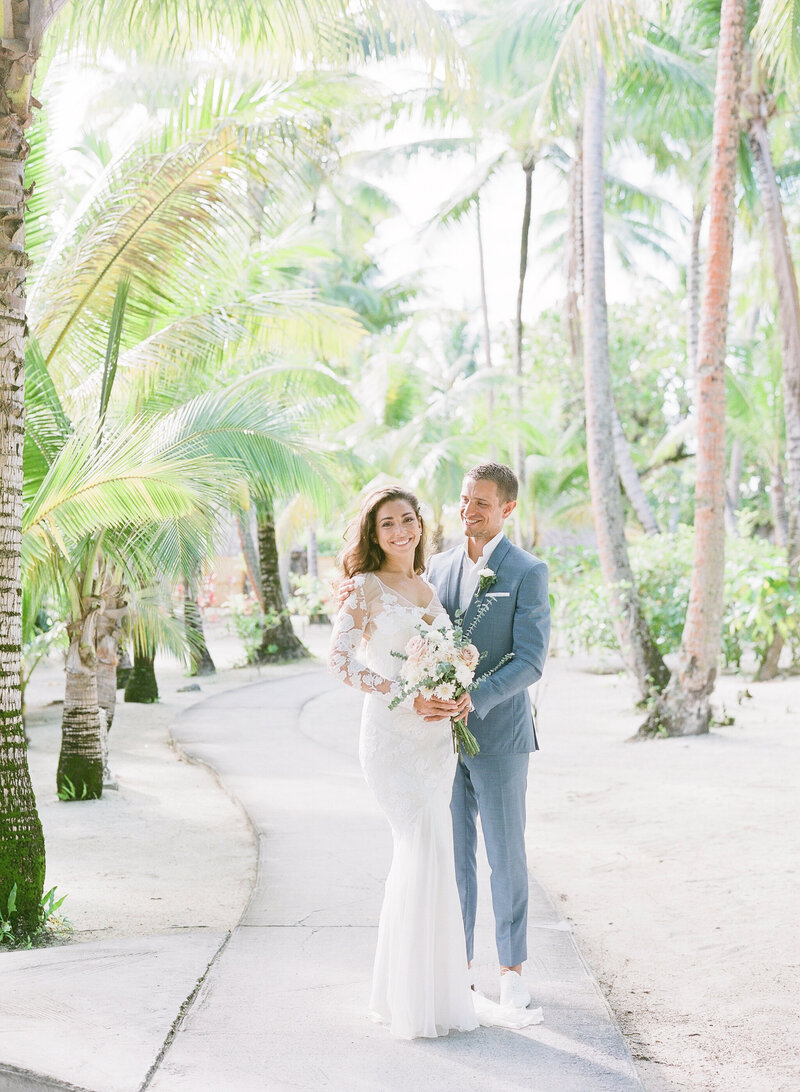 The bride and Groom under the palm during the portrait photoshoot at the Tahaa Island resort