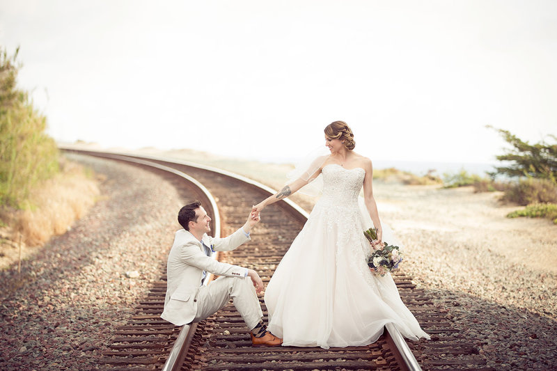 Seagrove Park wedding photos fun couple on train tracks