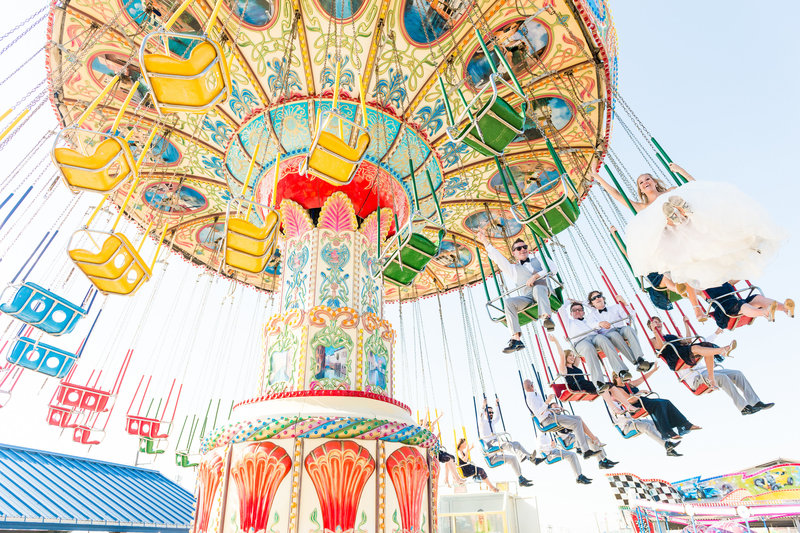 Bride and groom and bridal party ride carnival ride