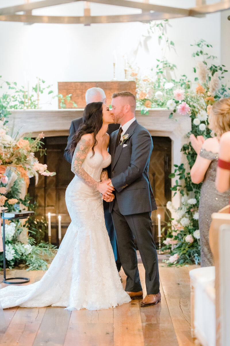 first kiss during ceremony at French Inspired Private Estate wedding in charlottesville virginia by costola photography