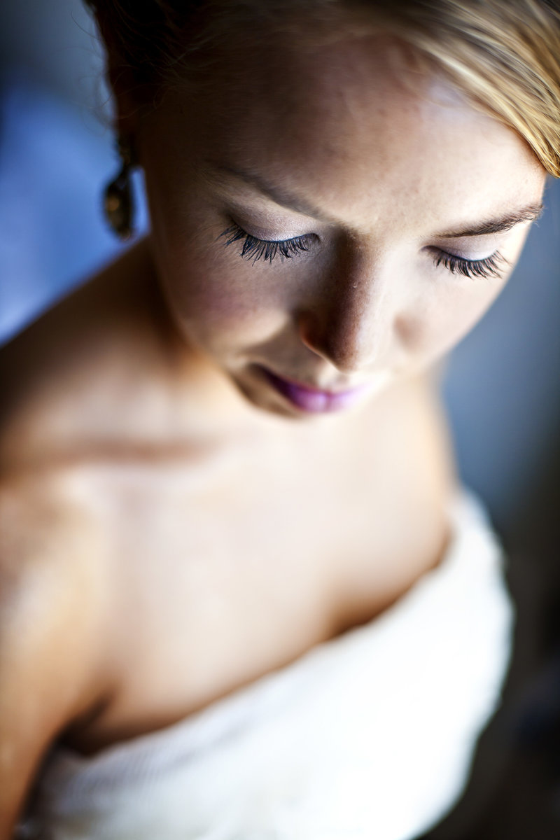 A soft light bridal portrait focusing on her eye lashes.