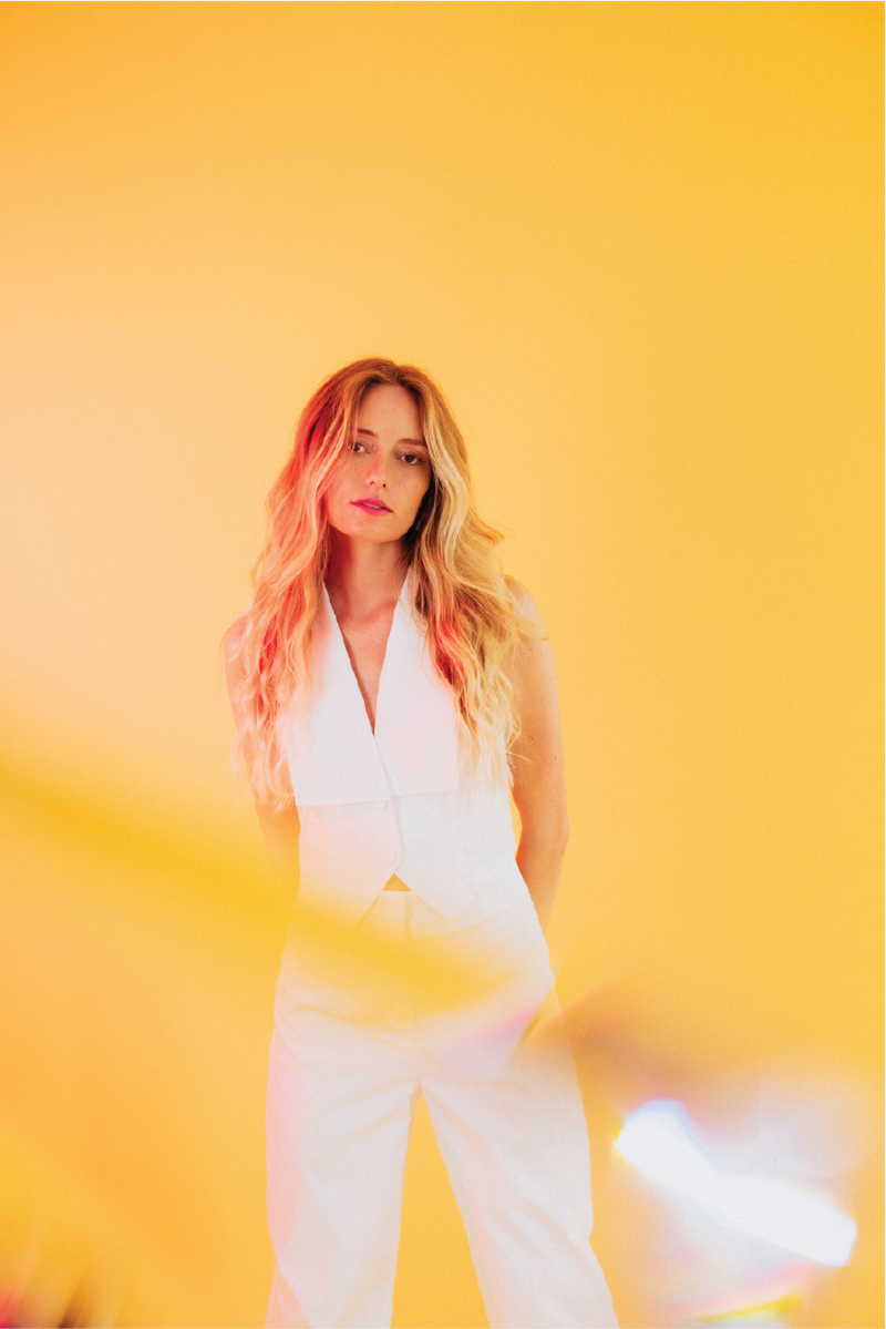 blonde-white-suit-yellow-background@2x