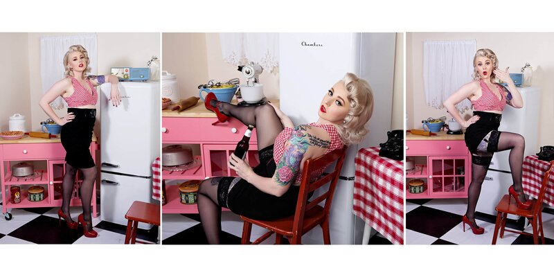 a blonde pinup girl in a black skirt and red checkered crop top posing in our pinup kitchen
