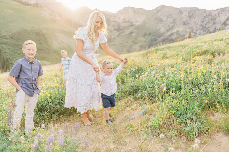 A golden family session nestled in the green rolling hills of Provo Canyon, Utah. Outdoor family sessions in Utah  are a specialty by Dana Sophia Photography