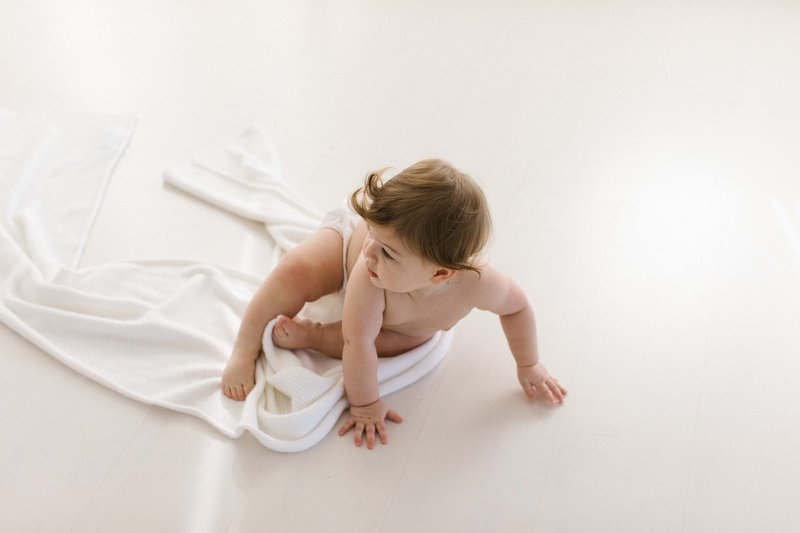 Baby girl in white Chicago studio, photo by Elle Baker Photography