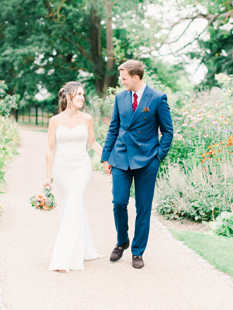Bride and Groom holding hands for their romantic heirloom portrait