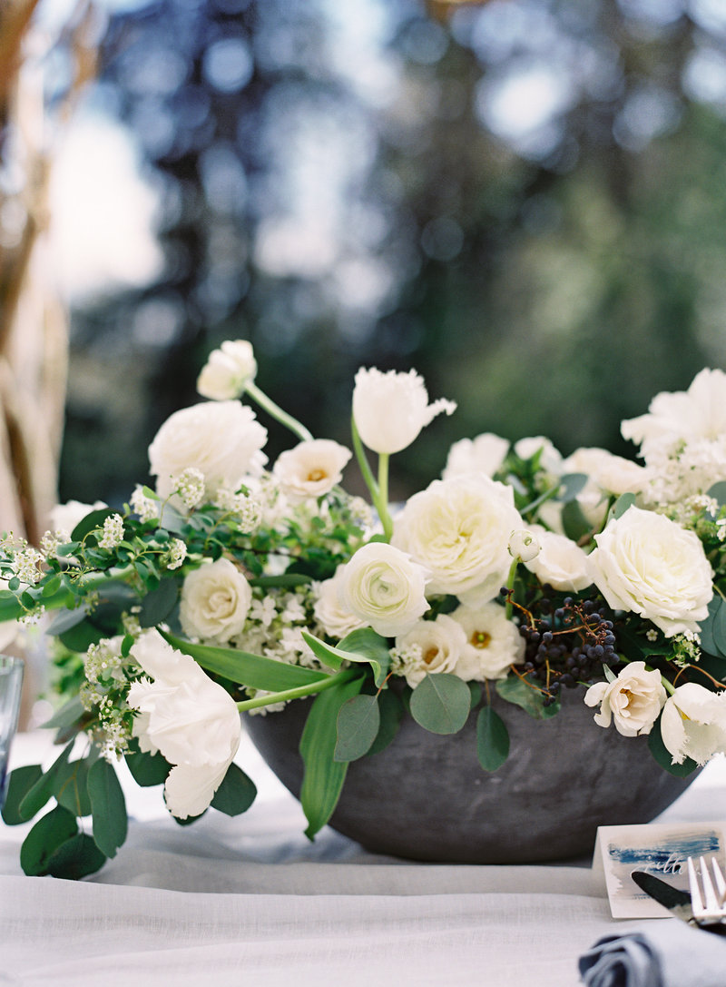 White garden inspired flower arrangement centerpiece