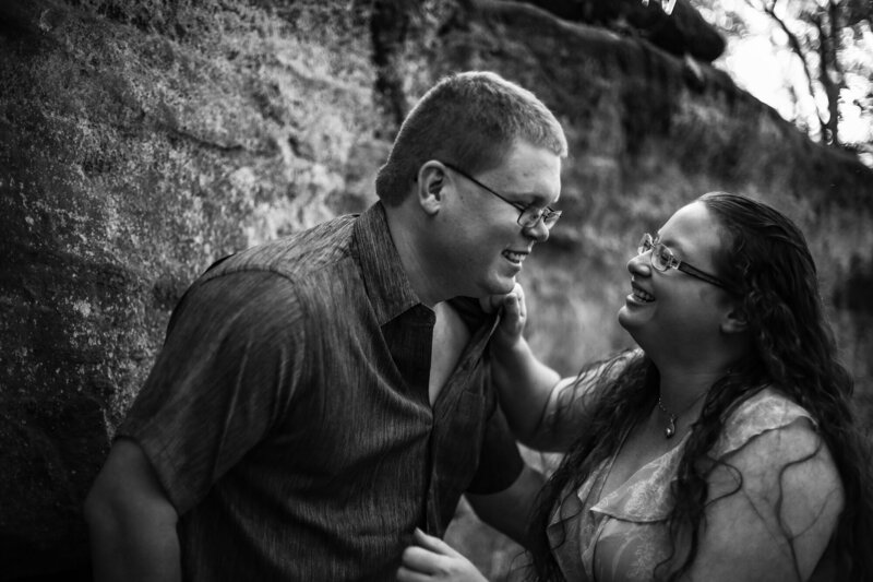 Engaged couple laughing together at Jakes Rocks overlook in Warren PA