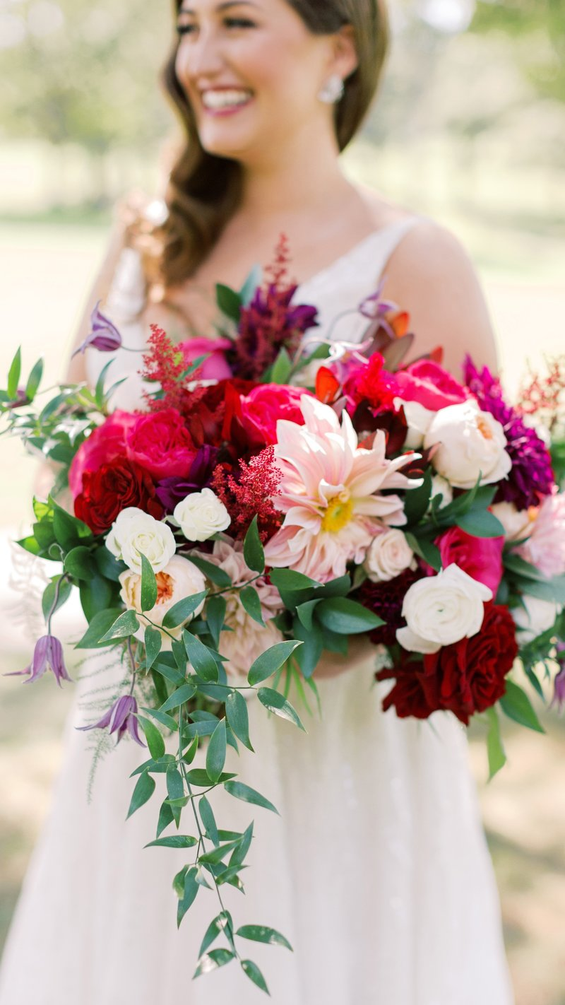 Bride with jewel tone flower bouquet