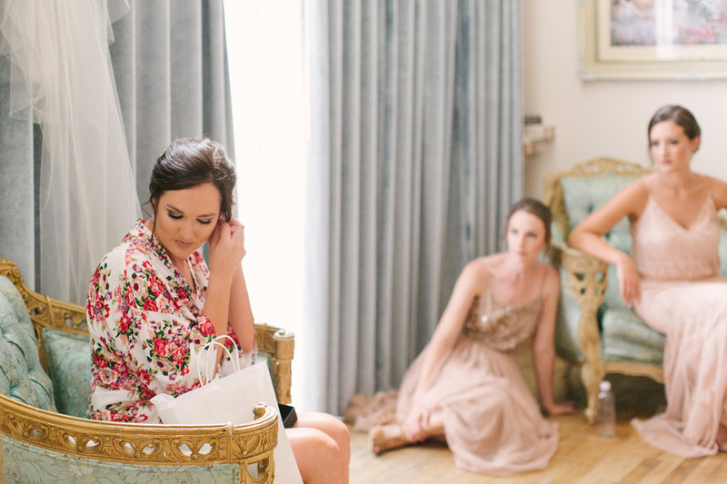 Bridesmaids look at bride at 1880 Union Hotel