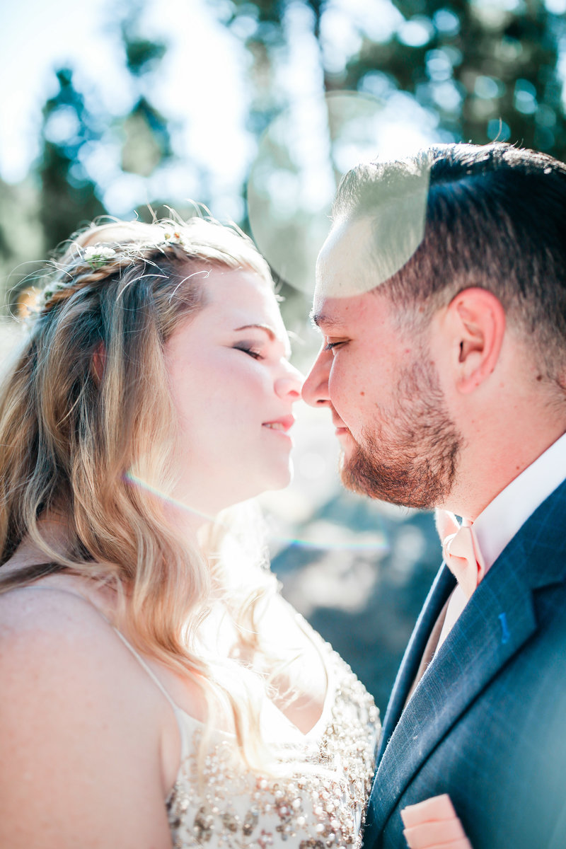 bride and groom kissing on wedding day