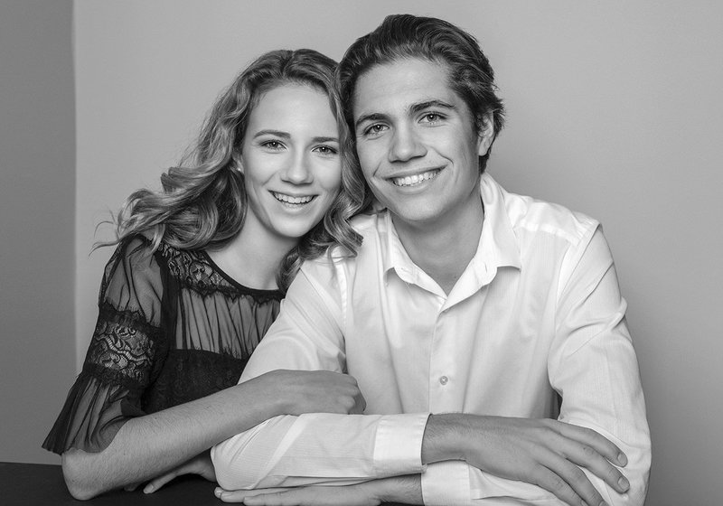 young son with his mother in black and white portrait