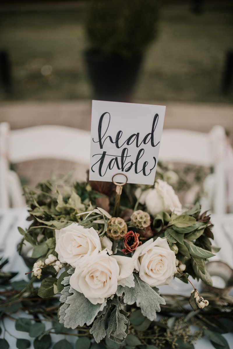 Head table arrangement for bride and groom at The Inn at Carnall Hall , Fayetteville, AR reception