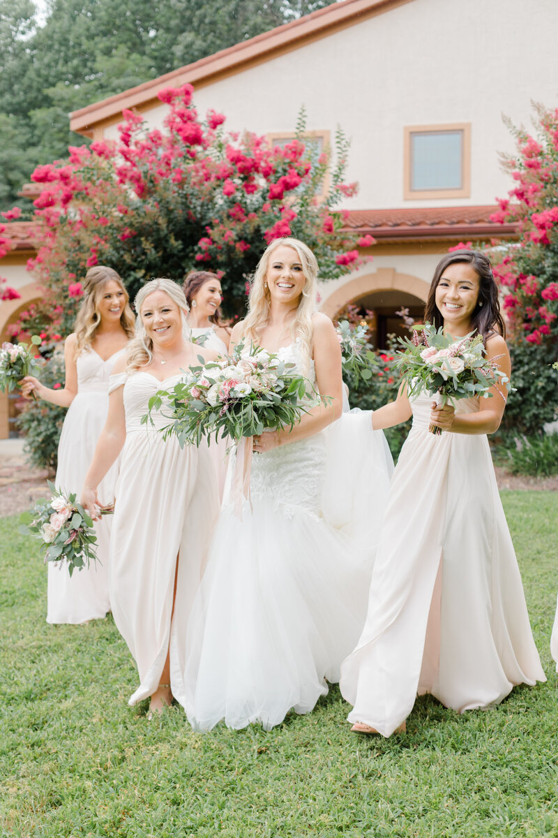 bridesmaids walking to ceremony at Running Hare Vineyard Wedding photographer costola photography