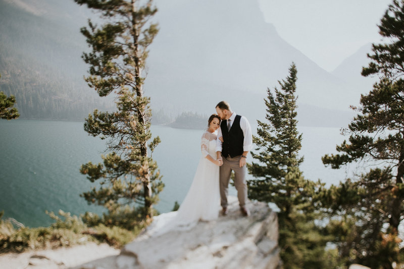 Glacier Park MT Elopement Couple Embracing by Lake