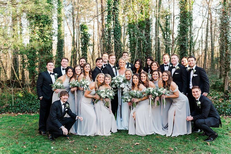 the whole wedding party standing together by Knoxville Wedding Photographer, Amanda May Photos
