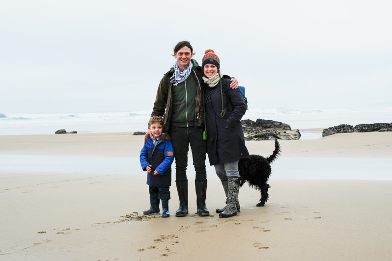 photo of charlie, her boys and her dog on the beach in cornwall