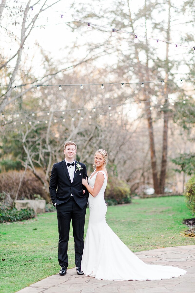 couple under twinkle lights by Knoxville Wedding Photographer, Amanda May Photos