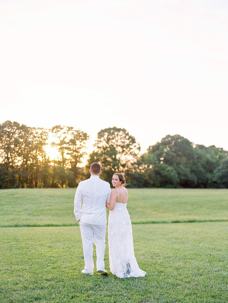 Bride and groom walking into the sunset