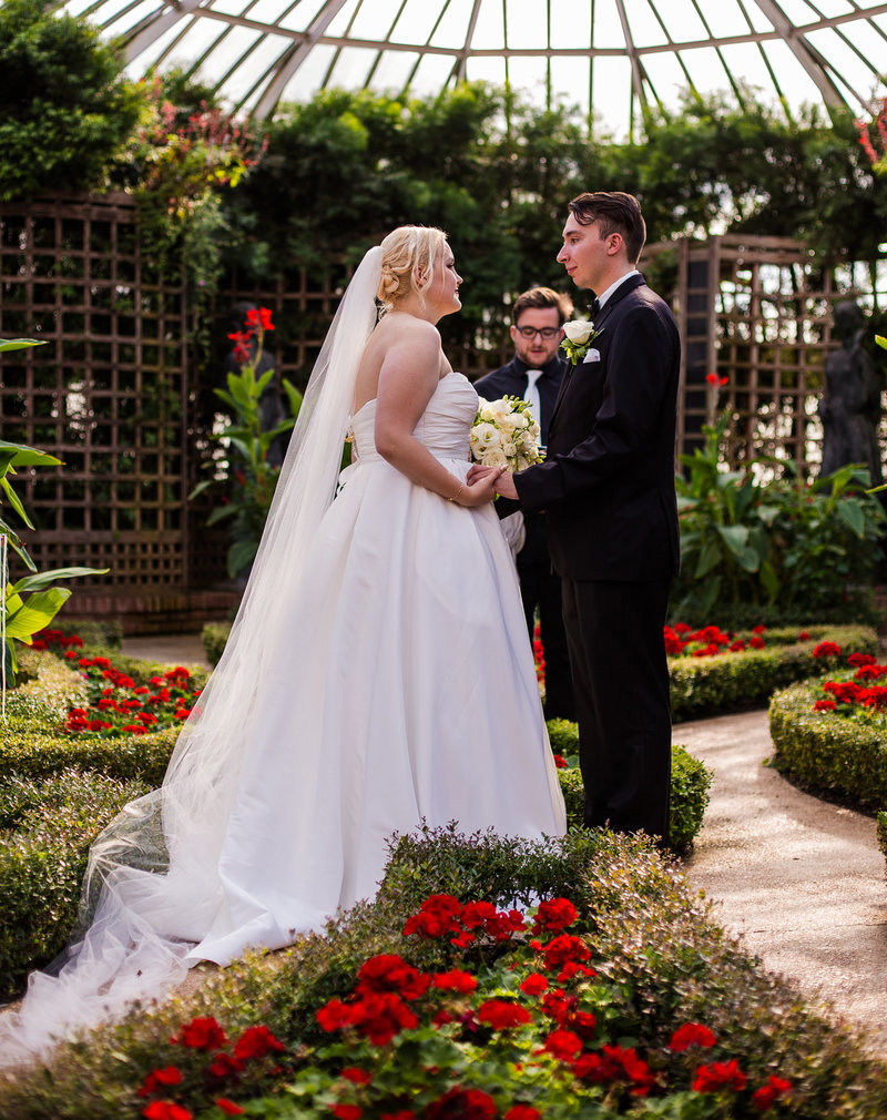 Bride and groom stand in front of officiant in Broderie Room for a Phipps Conservatory wedding