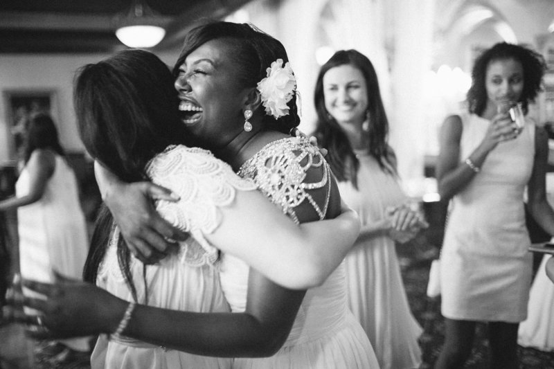 bride hugging guests and smiling at wedding St Louis Pinxit Photo