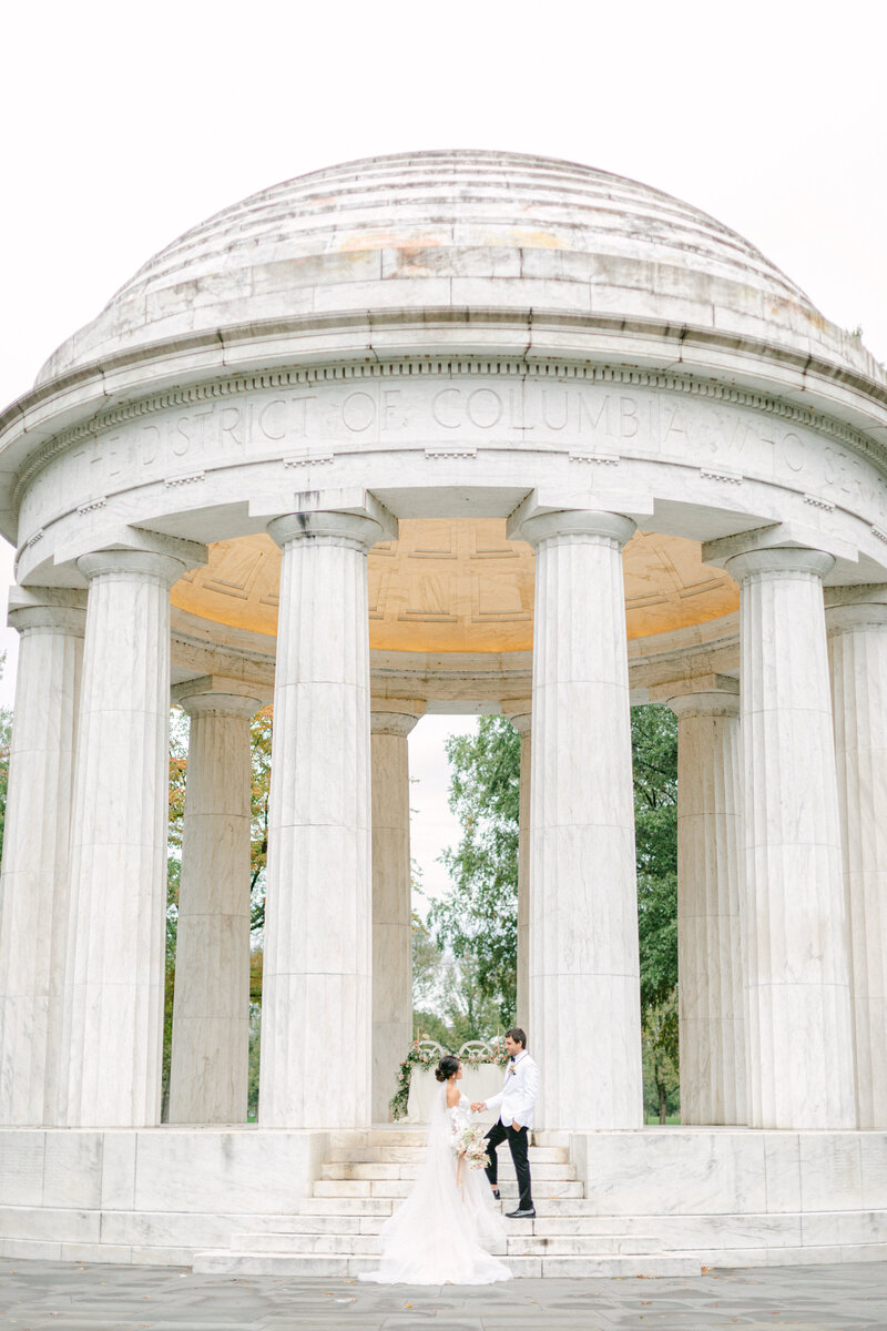 bride and groom in front of memorial at Washington DC Romantic Classic Wedding at the Lincoln Memorial by Costola Photography