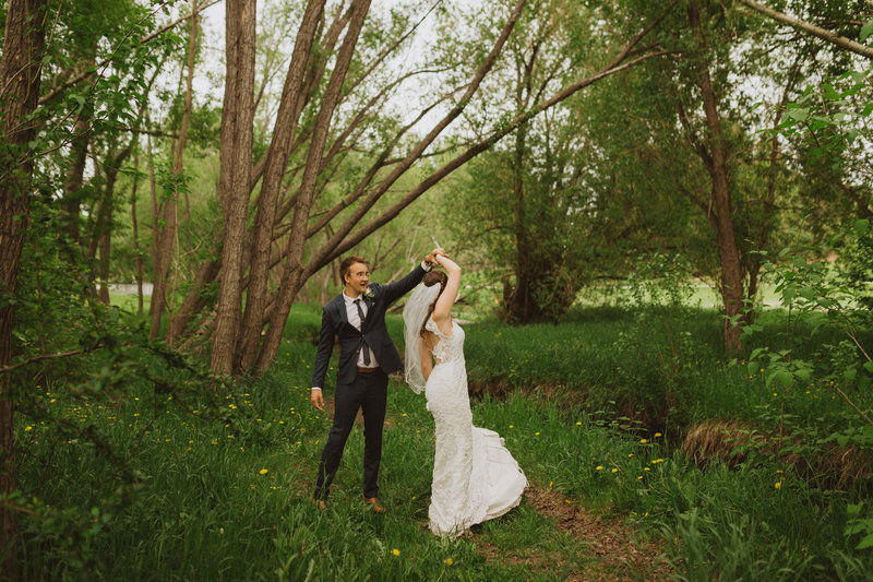 calgary wedding bride and groom dancing in the green forest
