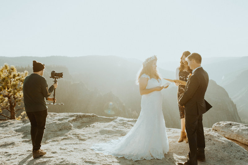 bride & groom getting married on  top of mountain