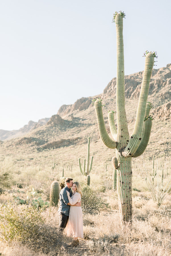Tucson Desert Engagement Session Photo of Couple Next to Saguaro Cactus at Gates Pass | Tucson Wedding Photographer | West End Photography