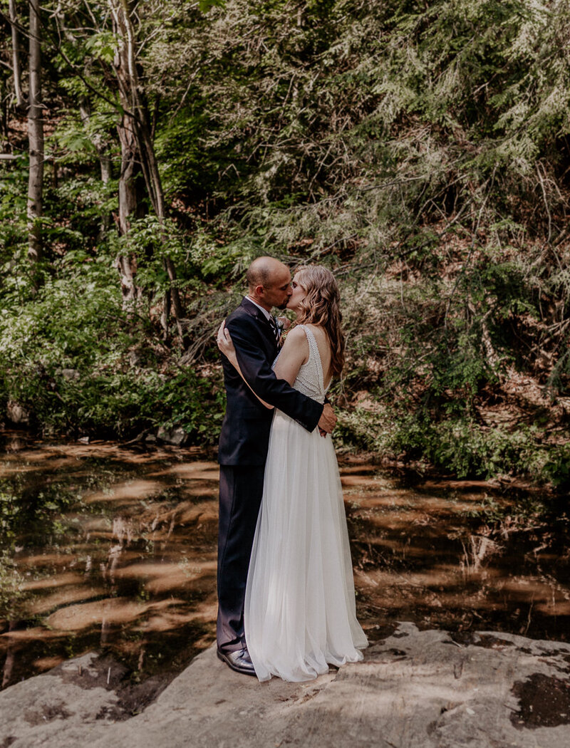 Couple kissing on their wedding day in Asheville, NC.