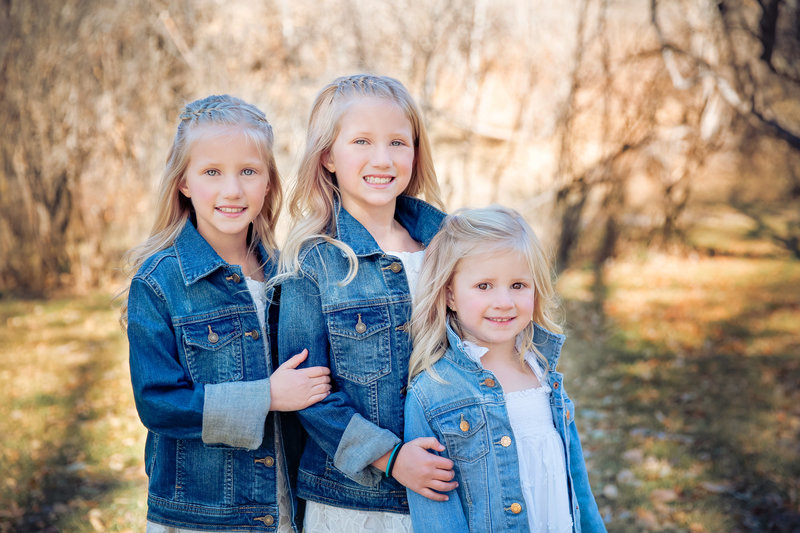 three beautiful young girls in jean jackets in the fall outdoors calgary