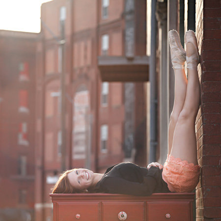Urban senior portraits, girl with ballet shoes is on dresser outside. And wrote great review for her photographer