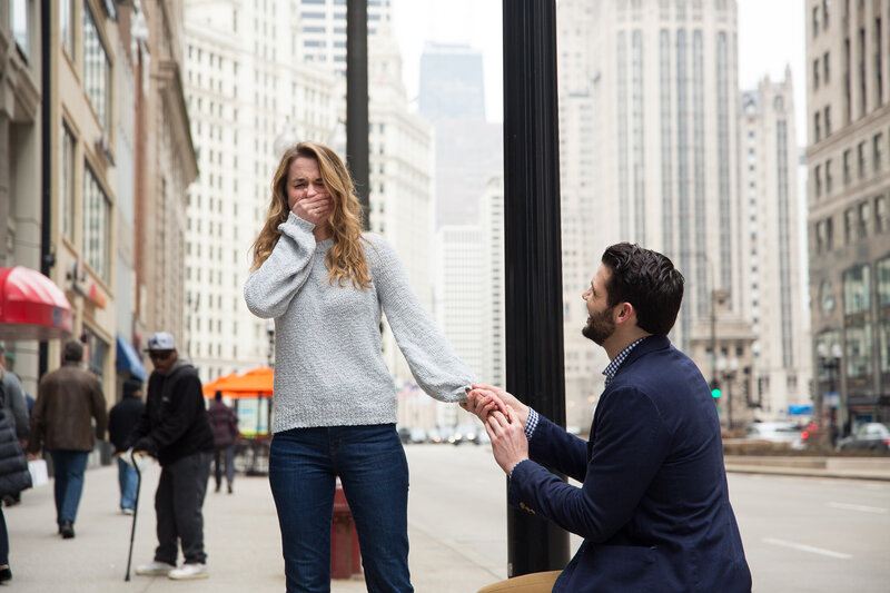 woman gasping from surprise engagement downtown chicago mag mile