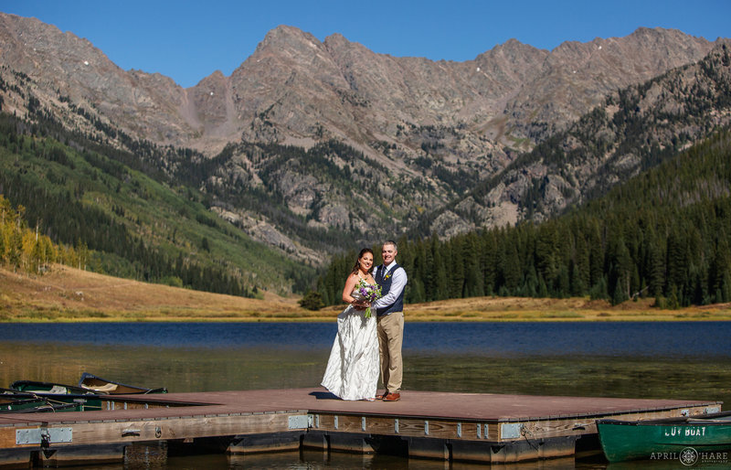 Bride and groom on the dock at Piney Lake