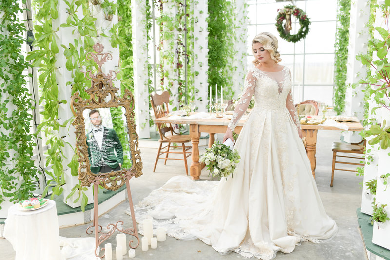 Gorgeous blonde bride in wedding gown holding bouquet