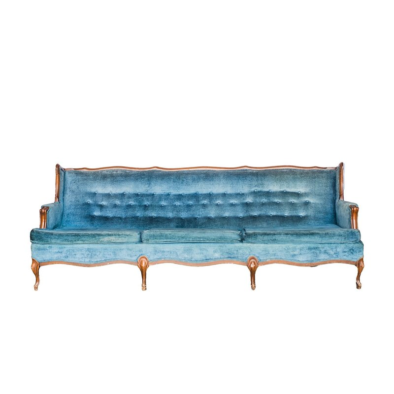 Soft terry cloth tufted sofa in a rich blue shade.
