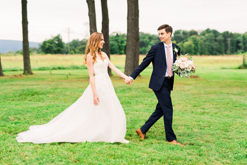 married couple with men holding bouquet at East Lynn Farm