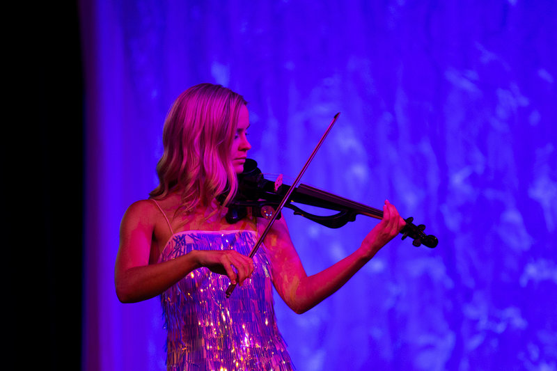 woman playing electric violin