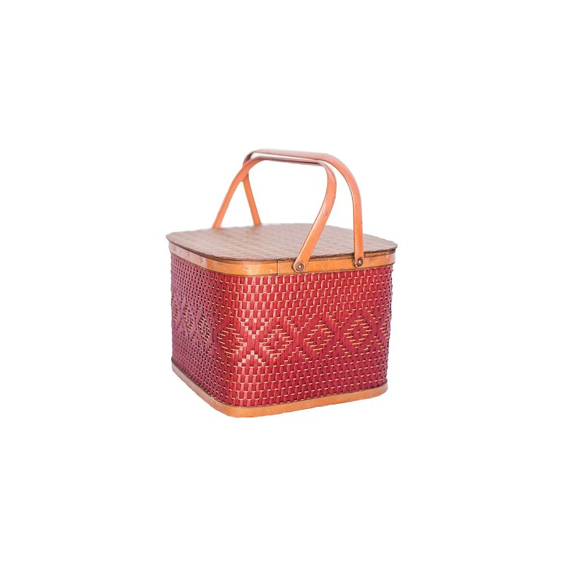Small, red, square shaped vintage red picnic basket.