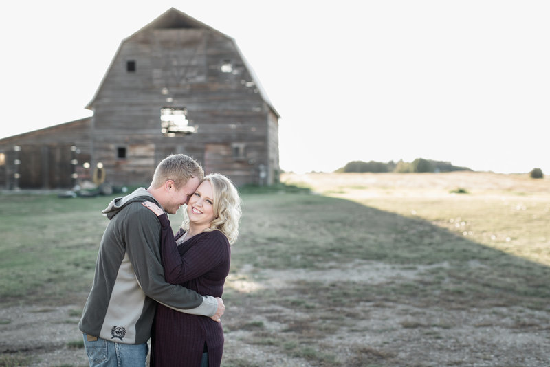 Red Deer Photographers-Raelene Schulmeister Photography- engagement photos-photos in front of a barn-rustic engagement photos